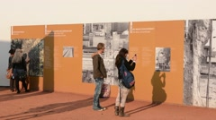 Berlin Germany Checkpoint Charlie museum Berlin Wall pieces tourists fear Stock Footage