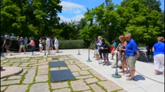 Washington DC famous Arlington National Cemetary with tourists at graves of JFK Stock Footage