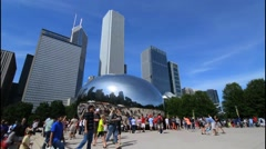Chicago Illinois Millennium Park with famous Cloud Gate sculpture called The - stock footage