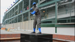 Chicago Illinois famous Wrigley Field statue of Ernie Banks Mr Cub  announcer - stock footage