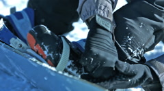 Boots clipping into snowboard bindings - stock footage