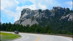 Mount Rushmore South Dakota Keystone traffic on road to National Memorial of  Stock Footage