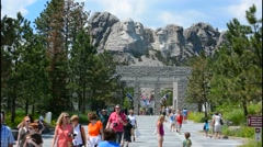 Mount Rushmore South Dakota Keystone entrance with flags to National Memorial of Stock Footage
