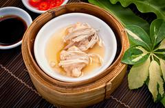 Dim sum in bamboo steamer Stock Photos