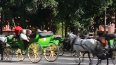 Marrakech Morocco main medina Djemaa El-Fna entrance with horse carriages going Stock Footage