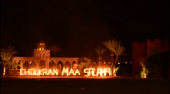 Marrakech Morocco Chez Ali famous attraction with Moroccan show  lights at end - stock footage