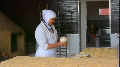 Tangier Morocco local woman baking bread in kitchen and oven Stock Footage