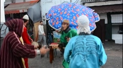Rabat Morocco main medina young arab boys in band with colorful outfits in - stock footage