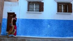 Rabat Morocco beautiful Kasbah Udaya blue walls interior with woman walking - stock footage