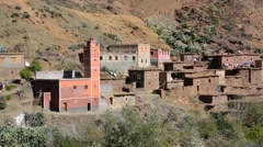 Morocco Taddart in Atlas Mountains old homes on cliffs in village poor area Stock Footage