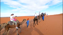 Morocco Sahara Desert sand dunes in Las Palmeras area with tourists riding Stock Footage