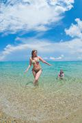 Mother and daughter bathe in the sea Stock Photos