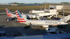 4K American Airlines airplanes at gates Stock Footage