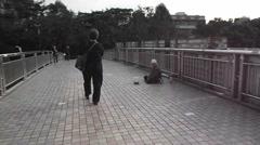 Stock Video Footage of The pedestrian bridge to the beggar, in Shenzhen