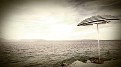 Lonely beach retro style umbrella on the mediterranean croatian shore Stock Footage