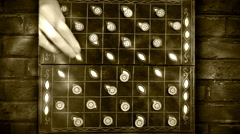 Draughts (checkers) game timelapse video with bricked background Stock Footage