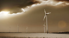 Wind generators in the fields of Austria, apocalyptic sky on the background Stock Footage