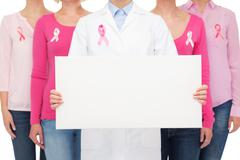 Close up of women with cancer awareness ribbons Stock Photos