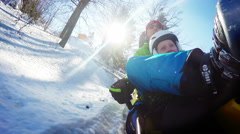 Father and son on the Bobsleigh attraction during winter holiday. Stock Footage