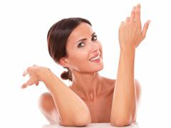 Stock Photo of Candid hispanic female gesturing up and smiling