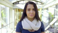 Mixed Race Teen Looks Down, Then Up At Camera With A Smile (Inside A Skybridge) Stock Footage