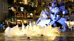 Large Venetian mask with alight fountain - stock footage