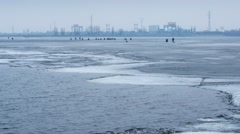 4k timelapse of many winter fishermen angling on ice Stock Footage