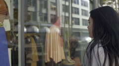 Mixed Race Young Woman Stops To Look At Window Display In City Stock Footage