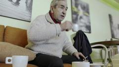 Elderly Man Drinking Coffee In A Cafe Stock Footage