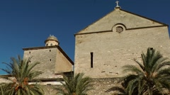 Spain Mallorca Island Alcudia 028 church nave above city wall with palm trees Stock Footage