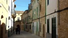 Spain Mallorca Island Alcudia 025 couple in old Spanish alley Stock Footage