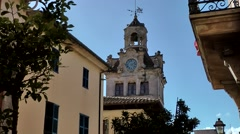 Spain Mallorca Island Alcudia 021 magnificent clock tower of city hall Stock Footage