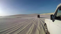 Off road jeeps driving through desert Stock Footage