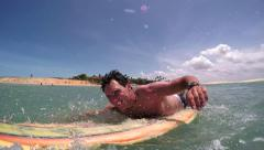 CLOSE UP: Young surfer paddling Stock Footage