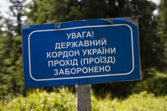 Sign in russian alphabet. State border of Ukraine. The crossing is prohibited. - stock photo