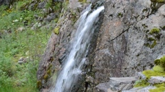 Small mountain stream waterfall over cliff side Stock Footage