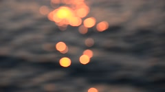 Nice sunset light bokeh on sea wave, Blurred light background Stock Footage