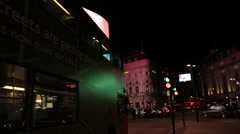 Piccadilly Circus Advertisement Boards with bus driving by at night - stock footage
