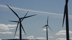 windmill farm on mountain top in autumn sun - stock footage