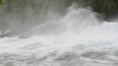 Melt water flooded violent river waterfall in summer Stock Footage