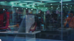 Two excited happy women looking in shop window Stock Footage