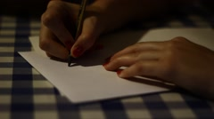 Woman writing a letter to boyfriend Stock Footage