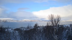 Blue sky and white clouds over blue fjord with tromsoe city island timelapse Stock Footage