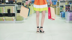 Woman With Shopping Bags Wearing High Heels Stock Footage