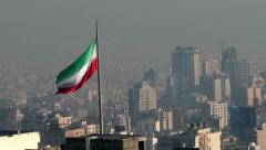 TEHRAN, IRAN JANUARY 2015: Iranian flag in the middle of Tehran city. - stock footage