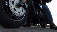 Low front angle of motorcycle going into gear and taking off Stock Footage
