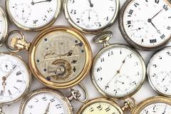 Various Antique pocket clocks on white - stock photo