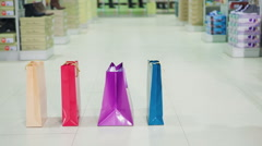 Woman with bags in shopping mall Stock Footage