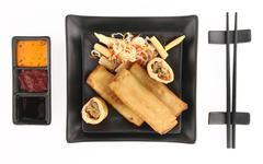 Spring rolls on a plate - stock photo