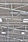 Ceiling with exposed beams in the exhibition hall Stock Photos